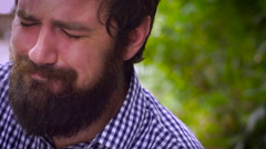 Dolly shot of a portrait of a bearded man severely depressed and crying Stock Footage