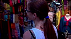 Woman exploring streets of Tunis Medina Stock Footage