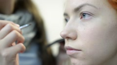 Make Up Artist And Beautiful Model Red On Set Stock Footage