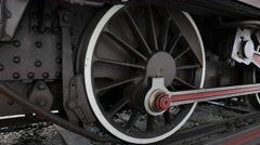 Steel wheels of an old steam train Stock Footage