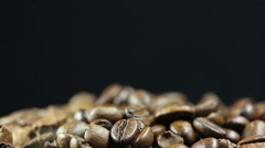 Roasting coffee beans on black background isolated Stock Footage