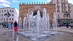 Water sprinklers in front famous Tunis wall doors Stock Footage