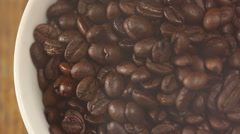 Roasting coffee beans intersperse into a pile close-up Stock Footage