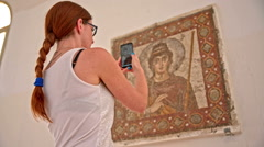 Taking a photo of Fatima mosaic on wall - stock footage