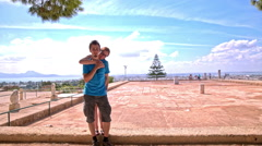 Couple standing at ruins of Carthage civilization Stock Footage