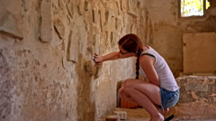 Person cleaning dust from old writings on wall Stock Footage