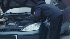 The man repairs a xenon headlight and checks Stock Footage