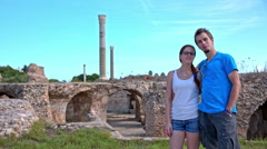 Couple posing in front of Carthage ruins Stock Footage