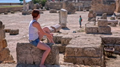 Woman observing ruins of Carthage spa Stock Footage