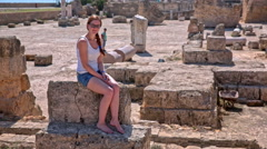 Female tourist posing on ruins of Carthage spa Stock Footage