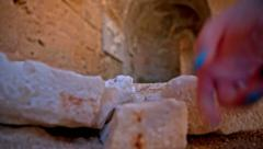 Putting together broken carved stone Stock Footage