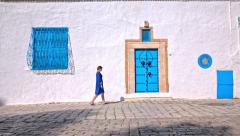 Person walk on Sidi Bou Said street Stock Footage