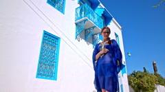 Female tourist in Arabic traditional Sidi Bou Said dress Stock Footage