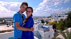 Couple hugging above the Sidi Bou Said village Stock Footage