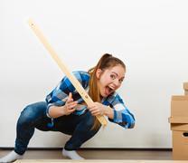 Woman assembling wooden furniture. DIY. - stock photo