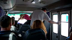Person sit down on small tour bus Stock Footage