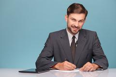 Attractive young tv reporter preparing for discussion - stock photo