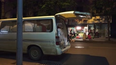 Van Parked On Street By Shops At Night City Of Chengdu China Stock Footage