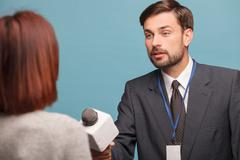 Attractive young journalist is interviewing the lady - stock photo
