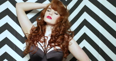 Sensual red hair woman wearing lingerie Stock Footage