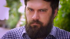 Portrait of a bearded man quietly being pissed off, angry, or mad - stock footage