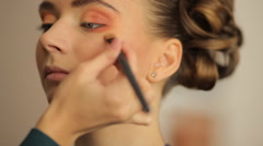 Make-up artist doing make-up before the show models Stock Footage