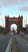 Barcelona Spain Arc De Triomf traffic bike vertical HD Stock Footage