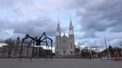 Notre Dame Basilica and a spider statue Stock Footage