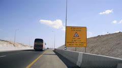 Beware of camels near the road sign, highway in Israel Stock Footage