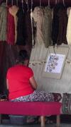 Stock Video Footage of Ephesus Turkey Turkish woman hand weave rug vertical HD