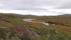 Arctic Tundra and River Landscape in Fall with Cloudy Sky Stock Footage