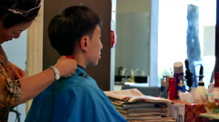 Young man having a hair cut in a hairdressing salon Stock Footage