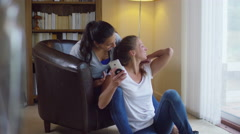 4K Young gay couple relaxing at home, get good news from a text message - stock footage