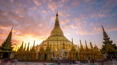 Early morning worshipers at Shwedagon Pagoda Stock Footage