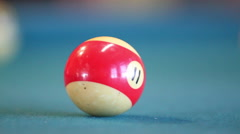 11 Ball hit into pocket by cue ball. Stock Footage