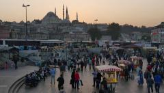 Street seller and the crowd around him in Istanbul. High angle view Stock Footage