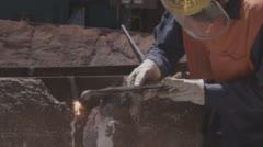 Close up of factory worker welding steel Stock Footage