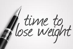 pen writes time to lose weight on white blank paper - stock photo