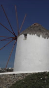Mykonos Greece white washed wind mills vertical HD Stock Footage
