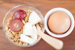 Granola with fruits and boiled egg Stock Photos