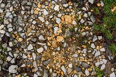 Stock Photo of Stone rubble underfoot. Grunge background texture.