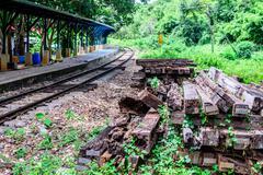 Unused wooden railway sleepers near railroad. - stock photo