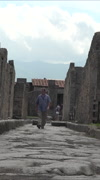 Naples Italy Pompeii man walking forward ancient road vertical HD - stock footage