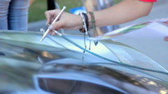Footage of a car being painted with airbrush Stock Footage