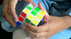 Close shot of a child playing with Rubik's Cube. - stock footage