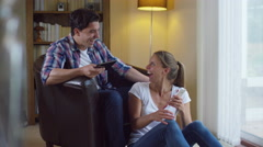 4K Attractive young couple relaxing at home, get good news from a text message - stock footage