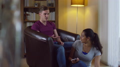 4K Relationship issues - attractive young couple having a disagreement at home - stock footage