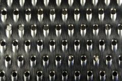 Close-up macro shot of a worn and used metal kitchen cheese or food grater Kuvituskuvat