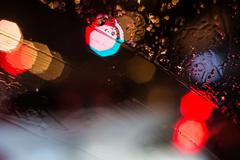 Stock Photo of Car headlamps and street lights at night create bokeh style defocused blurs a