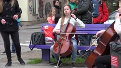 Girl musician cello trio and soloist sing in street for people. 4K Stock Footage